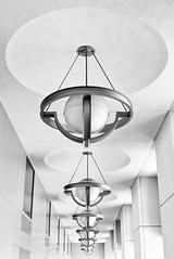 Seven (StefanB) Tags: california bw monochrome architecture lights museumofart geometry perspective sanjose delete3 hallway walkway g1 save10 geotag repitition 2010 sanjosemuseumofart hotbox fav10 1445mm fav25 flvonmirikr top102010 savedbythehotboxuncensoredgroup