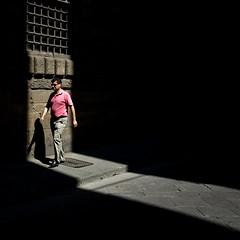 Via dei Leoni - 2nd edit (Gary Kinsman) Tags: italy italia florence firenze canon5d toscana tuscany canon1740mmf4l backstreet alley medieval renaissance old narrow viadeileoni candid street photography life light shaft shadow wall walk past 2010 people person