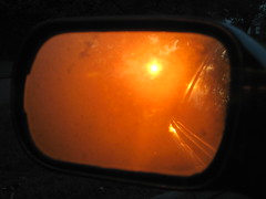 sunrise in the car mirror
