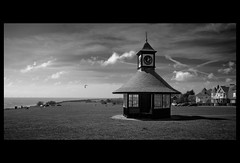 Shelter from the English summer (alwyncooper) Tags: sea blackandwhite cloud mer house seascape black beach monochrome architecture marina canon landscape eos mono mar seaside mare sigma cooper 1020mm  essex plage    xsi      alwyn  frintononsea   sigma1020mmexdc  450d digitalrebelxsi eosxsi    alcooper  alwyncooper