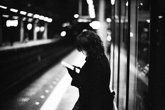 Last Train Home (moaan) Tags: leica light bw woman night 50mm reading dof bokeh platform f10 utata noctilux m3 2011 momochrome leicam3 lasttrain fujineopanpresto1600 leicanoctilux50mmf10 waitingforthelasttrain downplatform gettyimagesjapanq2