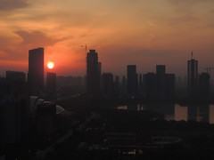 Beautiful sunrise in modern Chinese city - Hefei, China (Germán Vogel) Tags: asia eastasia china travel traveldestinations traveltourism tourism touristattraction landmark holidaydestination famousplace anhuiprovince hefei city cityscape urbanlandscape urbanskyline building skyline skyscraper development growth economicgrowth financialdistrict sunrise sunset sun silhouette swanlake