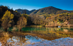Rijecki reflections (snowyturner) Tags: river lake skadar autumn trees reflections symmetry landscape montenegro boat mountains naturists