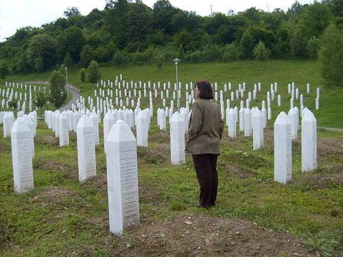 Beba looks for her relative at the Srebrenica-Potocari Memorial Center