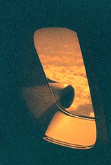 I WANT TO GO HOME!! (mi..chael) Tags: sky film window airplane lca lomography superia fujifilm selfmade boeing747 135mm upperdeck xtra400 redscale iwanttogohome