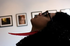 Gallery Chic (Elise Bonilla-Myers) Tags: venice red cute girl sunglasses whitewalls artgallery hipster feather mexican photographs chic curlyhair nicaraguan redfeather salvadorian photographyshow featherearing photographygallery venicebeachcalifornia