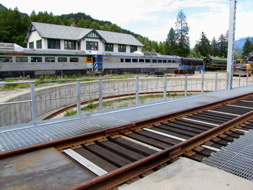 Railway Track at Turntable with Squamish Station at back. Royal Hudson 2860 Steams Into CN Roundhouse in Squamish BC