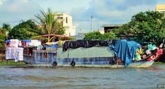 bateau sur le Mékong (pontfire) Tags: voyage trip travel portrait woman man men river children boats boat women asia vietnam childrens asie mekong cantho marchéflotant