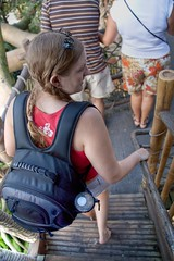 A shot of Sarah descending from the Swiss Family Robinson Tree House.  Not much going on here, but I did feel the need to document her wearing the backpack. (colorblindPICASO) Tags: people tree sarah stairs florida backpack barefoot pigtails waltdisneyworld magickingdom redshirt steppingdown braidedhair descalça descalza piedsnus piedinudi swissfamilyrobinsontreehouse scalza
