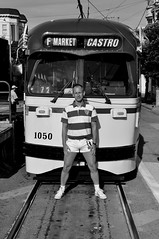 Standing in front of the F-Line / Muni Metro Trolley in the Castro District - San Francisco, California - Black and White (Blue Rave) Tags: sf sanfrancisco california people blackandwhite bw signs sexy male men guy face sign train athletic legs metro trolley transport tram dude muni thighs castro transportation transit shorts mate publictransport streetcar stud bloke 2010 fline castrodistrict