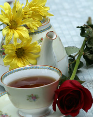 Tea and flowers (hillzw427) Tags: red stilllife rose yellow daisies canon tea beverage teaset