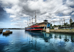Honolulu Blue (` Toshio ') Tags: ocean blue red sea reflection building tower water architecture clouds hawaii harbor paradise ship pacific oahu vessel hawaiian honolulu ripples hull tallship aloha hdr highdynamicrange toshio alohatower maritimecenter theunforgettablepictures