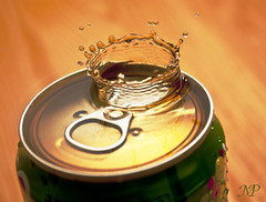 Soda Crown .. ! (|| Msh3L Alomran ||) Tags: macro apple water speed canon photography drops high action flash drop fluid crown soda splash liquid fanta ksa splashing   kfupm  430ex              1000d liquiddrops