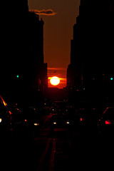 Manhattanhenge sunset (DaveMosher) Tags: street city newyorkcity sunset sun bird cars manhattan