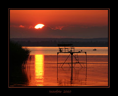 (tozofoto) Tags: light sunset summer sun lake reflection reed water colors birds silhouette clouds canon gold pier boat hungary waterfront platform summertime balaton angler reedy somogy theunforgettablepictures tozofoto