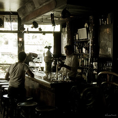 hot, languid days (moggierocket) Tags: old summer window beer caf amsterdam bar dark glasses pub interior d200 bartender ordering