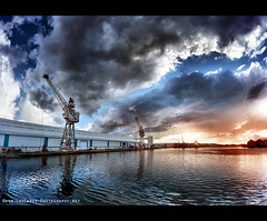 Incoming Storm 2 (Lee Carus) Tags: uk sunset red sky colour water docks skies sony dramatic fisheye cranes birkenhead alpha wirral merseyside a900
