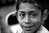 En las calles de Ataco :: Life on the streets (Jorge Romen) Tags: poverty portrait bw smile canon tristeza kid gente retrato homeless elsalvador sonrisa indigente pobreza cafecito callejero vagabundo jorgerodriguez pordiosero 40d realidadsocial niñopobre jorgeromen jorgeromenphotography