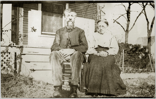 man and woman in the front yard