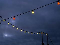 night lights (friendlydrag0n) Tags: light sea sky night dark seaside darkness dusk illumination string hanging colored coloured festoon