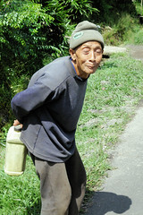 Old Man Out For A Walk With His Plastic Container (cwgoodroe) Tags: new old school summer bali sun stone kids children indonesia rice statues agriculture mountians patties riceterraces ubud seminyak batubulan
