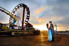 Early Morning Passion (Extra Medium) Tags: morning clouds sunrise dawn pier engagement kiss santamonica ferriswheel amusementpark embrace strobist californiaweddingphotographer losangelesweddingphotographer orangecountyweddingphotographer santabarbaraweddingphotographer venturaweddingphotographer malibuweddingphotographerbeachengagementjasonpiersantamonicasarahuclawestwood