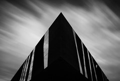 the Forum (Geoffrey Gilson) Tags: barcelona bw white motion black building architecture clouds canon de eos design spain triangle long exposure noir geometry forum dramatic symmetry nb sharp exposition le 7d geoffrey nuages espagne blanc barcelone mouvement batiment prim gilson triad rambla 100000 geometrie symetrie longue pierredemeuron peaked pointu neverstopexploring dramatique supershot flickrsbest bej abigfave jaquesherzog theunforgettablepictures overtheexcellence canoneos7d bestminimalshot rambladeprim geoffreygilson 2004universalforumofcultures wwwgeoffreygilsonnet eguise