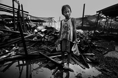 Typhoon Esther in Ulingan (charcoal) , Tondo, Manila (Mio Cade) Tags: life boy portrait water kid factory child flood humanity philippines social charcoal disaster manila damage environment esther rai magnum raghu typhoo tondo ulingan