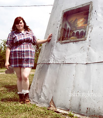 Paradise awaits (Kryptomaisonaut [[Ash Foxglove]]) Tags: portrait selfportrait abandoned window girl grass self dress boots kentucky ky bbw williamstown teepee plaid metalteepee