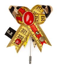 Printed Pleasures bow (RJL Designs) Tags: fashion handmade brooch jewelry wearableart oragami textileart harajukugirls tapemeasure fabricjewellery fashionjewellery contemporaryjewellery artjewellery textilejewellery retrojewellery catwalkjewellery tapemeasurejewellery rjldesigns