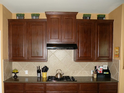 How To Decorate The Top Of Your Cabinets An Easy Trick House Of - How to decorate top of kitchen cabinets