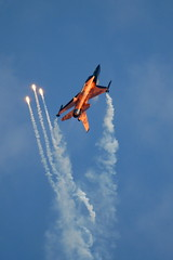 RNLAF demo team F-16 with flares (J Saari) Tags: aviation military aeroplane airshow f16 flare airforce demoteam generaldynamics f16a rnlaf a700 pirkkala j015 eftp tias2010