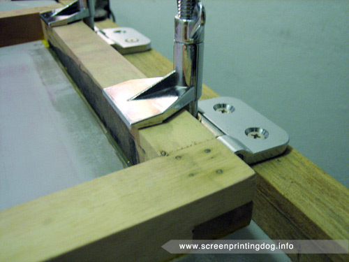 place screen in printing clamps