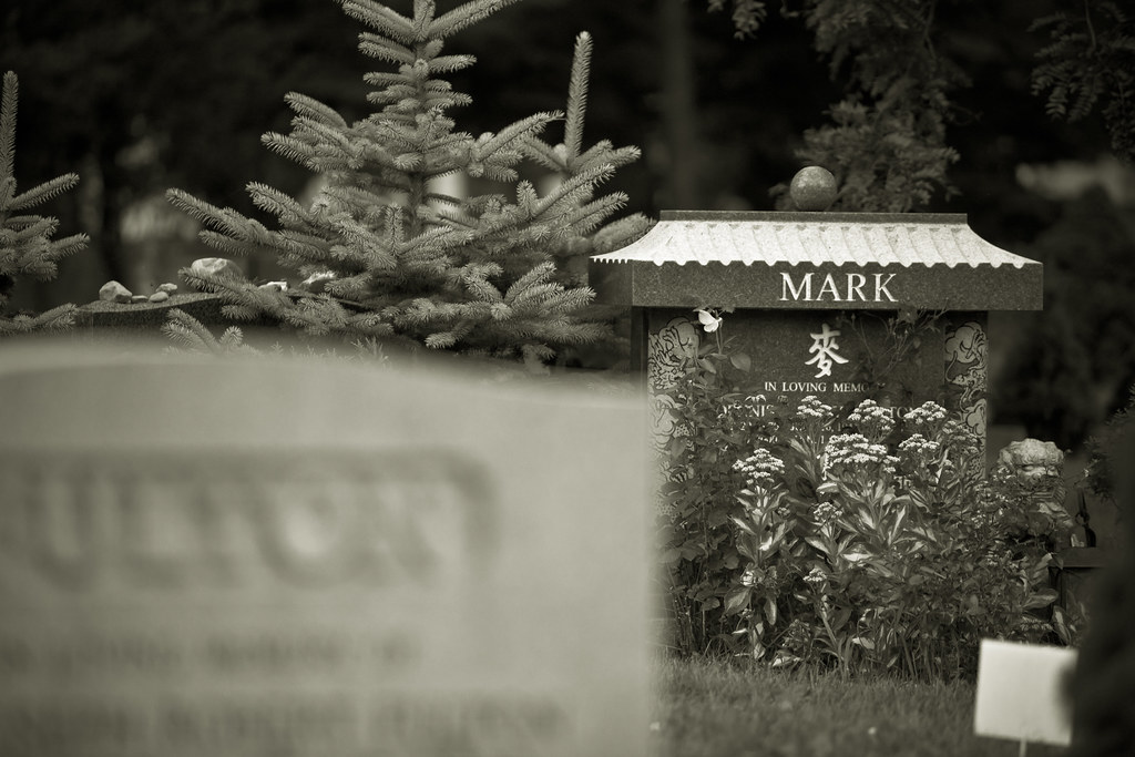 the grave site of dennis mark at mount pleasant cemetery in toronto