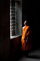 Angkor Wat Monk (Benjamin Edwards) Tags: light 2 blackandwhite orange window nikon cambodia southeastasia thought buddha monk buddhism angkorwat explore winner frontpage guardian contemplation d300 underexposure explored yourpictures rentamonkcom 13thnovember2010