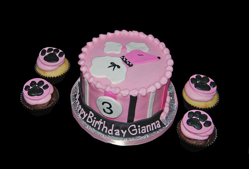 Black and Pink Poodle Cake with Paw Print Cupcakes for a 3rd Birthday celebration