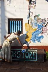 Okstore (Jos5941) Tags: woman india water colors shop canon catchycolors painting colorful asia books bookstore cleaning asie gokarna karnataka inde angers okstore gokarn incredibleindia josefernandez josfernandez