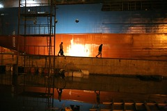 Down to the waterline (N A Y E E M) Tags: nightphotography light reflection dock workers ship silhouettes latenight shipyard bangladesh drunkphotography chittagong canonef50mmf14usm canoneos5d nayeemkalam westernmarinelimited