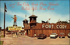 Greetings from Fort Cody Trading Post, North Platte, Nebraska. Postcard 4831-C. Published by Dunlap-Henline, (ca. 1950s) (lhboudreau) Tags: history historical buffalobill williamfcody buffalobillcody buffalohunter williamcody wfcody colwfcody indianfighter scout williamfrederickcody colonel postcard vintagepostcard postcards regalia cowboyhat oldwest wildwest postcard4831c 4831c americanwest dunlaphenline greatscout thegreatscout colwmfcody buckskin buckskins rifle fortcody tradingpost northplatte nebraska 1950 northplattenebraska greetings hometown log logs tower towers sentrytowers sentrytower fortification wall walls buffalobillsign stockade gifts westerngifts armedguards canon canons fort