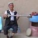 Uyghur man playing traditional lute (rawap)