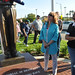 Diana Shaw admires statue of young boy holding a flag, the focal point of new Granada Hills Veterans Park