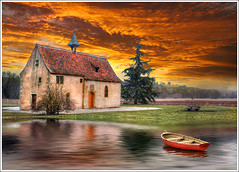 The red boat (Jean-Michel Priaux) Tags: sunset sky orange lake france art church nature water abbey rock architecture fairytale clouds photoshop river painting landscap