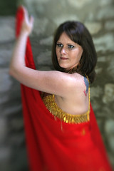 Dancer, In Red (Gordana AM) Tags: old light woman ontario canada church girl vertical stone angel dark hair island team wings eyes long pretty dancers dancing stage posing dancer location hobby belly expressive cape windsor material desaturated walls oriental performers promotional colouring bellydancers freelance selective hite troupe bablo localbusiness enrobed class2010 lepiafgeo happybirthdaylensbaby