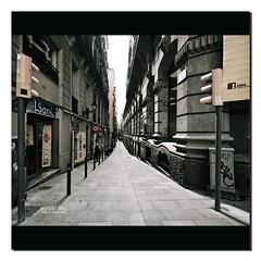 ---------/ \--------- : Converging Street :: Barcelona (Sushil) Tags: barcelona street born el lamppost barceloneta shops converging abigfave oplly