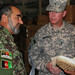 Col. Mir tells U.S. Army Brig. Gen. John McGuiness about the quality of the new boots (11 JUL 2010)