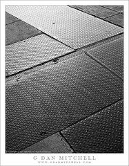 Sidewalk and Steel Plates (G Dan Mitchell) Tags: sanfrancisco california city urban blackandwhite usa abstract reflection building texture monochrome ferry concrete glow steel stock cement plate diagonal sidewalk driveway embarcadero northamerica minimalism crisscross