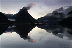 milford sunset #3 (Daniel Murray (southnz)) Tags: park sunset sea newzealand cloud mist mountain snow reflection water rock stone landscape coast scenery national nz sound southisland milford fiord fiordland southnz