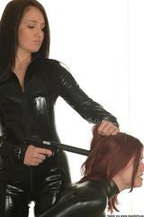 Execution (Floyd Rosen) Tags: girl gun rubber latex catsuit pvc silencer hitwoman