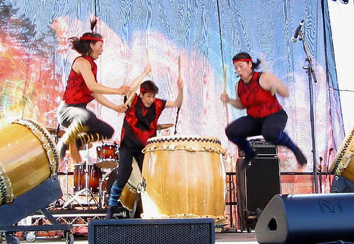 All Three Uzume Drummers Jump Up Before Hitting the Big Drum, Surrey Fusion Festival 2010 Multicultural and Diversity Celebration in Greater Vancouver