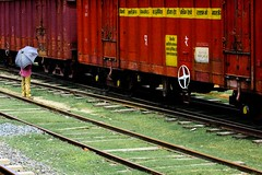 In state...[Abdulpur Station] (Sady_Sad) Tags: man station train umbrella hindi railline tamron1750 canon50d